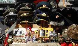 <p>File photo of memorabilia of the former East German regime on sale at former Allied Checkpoint Charlie on the site of the former Berlin Wall in Berlin, July 27, 2009. REUTERS/Fabrizio Bensch/Files</p>