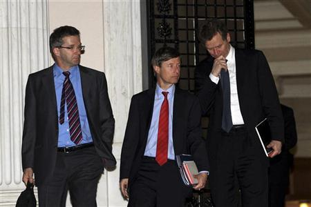 International Monetary Fund's (IMF) Poul Thomsen (R), European Central Bank's (ECB) Klaus Masuch (L) and European Commission Director Matthias Morse leave the Greek Prime Minister's Lucas Papademos office in Athens January 20, 2012. Greece was closing in on an initial deal with private bond holders on Friday that would prevent it from tumbling into a chaotic default but lose investors up to 70 percent of the loans they have given to Athens. REUTERS/Panagiotis Tzamaros