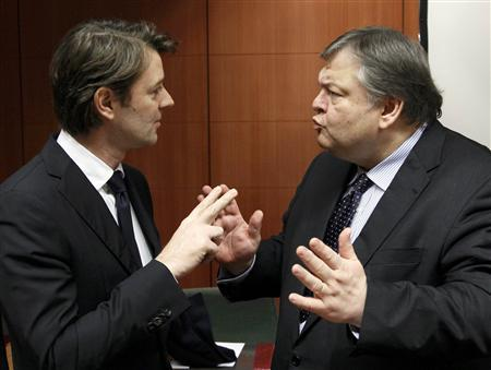 France's Finance Minister Francois Baroin talks with Greece's Finance Minister Evangelos Venizelos at a Eurogroup meeting at the European Union council headquarters in Brussels January 23, 2012. REUTERS/Yves Herman.