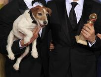 "<p>Uggie, the dog featured in ""The Artist"" is held next to the Golden Globe award the film won as best comedy or musical motion picture at the 69th annual Golden Globe Awards in Beverly Hills, California, January 15, 2012. REUTERS/ Lucy Nicholson</p>"