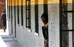 <p>A student is pictured at a school in Khutsong Township, 74 km (46 miles) west of Johannesburg August 22, 2011. REUTERS/Siphiwe Sibeko</p>