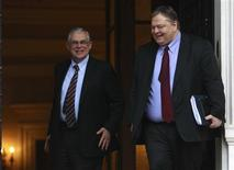 <p>Greece's Prime Minister Lucas Papademos (L) escorts Finance Minister Evangelos Venizelos after a meeting in Athens January 28, 2012. Greece and its private creditors head back to the negotiating table on Saturday to put together the final pieces of a long-awaited debt swap agreement needed to avert an unruly default. REUTERS/John Kolesidis</p>