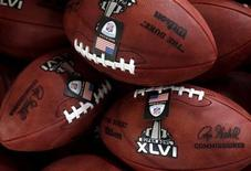 <p>Wilson footballs await packaging at the Wilson Sporting Good dedicated football factory in Ada, Ohio January 25, 2012. REUTERS/Matt Sullivan</p>