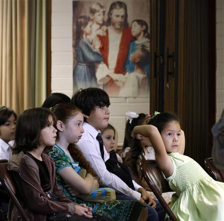Children attend Sunday school at the Belgrano Church of Jesus Christ of the Latter-day Saints in Buenos Aires, December 28, 2008. REUTERS/Marcos Brindicci