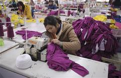 <p>Employees work at a garment factory in Wuhu, Anhui province February 1, 2012. REUTERS/Stringer</p>