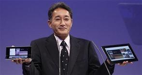 <p>Kazuo Hirai, President and Group CEO of Sony Computer Entertainment, presents the new Sony S tablet (R) and the P tablet during a news conference at the IFA consumer electronics fair in Berlin August 31, 2011. REUTERS/Tobias Schwarz</p>