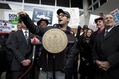 <p>Academy Award-nominated director Josh Fox speaks during a protest against hydraulic fracturing outside the Tribeca Performing Arts Center, Borough of Manhattan Community College in New York November 30, 2011. REUTERS/Andrew Burton</p>
