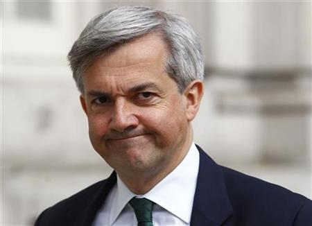 Britain's Energy Secretary Chris Huhne looks towards the media as he arrives for a cabinet meeting at Westminster in central London May 17, 2011. REUTERS/Andrew Winning