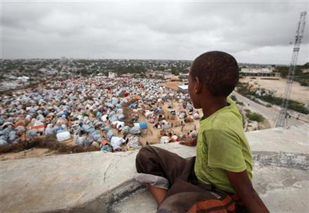 A boy sits looking over the Seyidka settlement for the famine stricken internally displaced people in Berkulan near Somalia's capital Mogadishu, September 6, 2011. REUTERS/Ismail Taxta