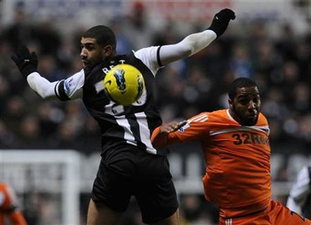 Newcastle United's Leon Best (L) challenges Swansea City's Kemy Agustien during their English Premier League football match in Newcastle, northern England December 17, 2011. REUTERS/Nigel Roddis