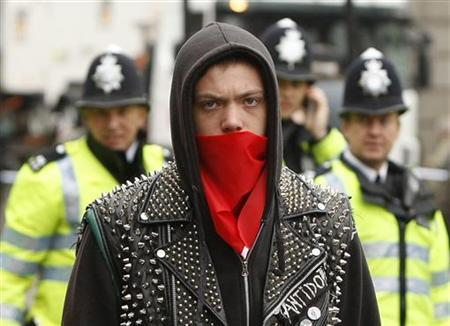 Demonstrators march through central London March 28, 2009. REUTERS/Stephen Hird