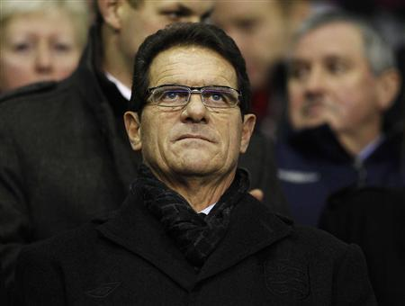 England manager Fabio Capello waits for the start of the English Premier League soccer match between Liverpool and Tottenham Hotspur at Anfield in Liverpool, northern England February 6, 2012. REUTERS/Phil Noble