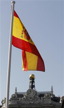 A Spanish flag flutters over the Bank of Spain in Madrid March 10, 2011. REUTERS/Andrea Comas