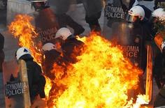 <p>A petrol bomb explodes at riot police during a huge anti-austerity demonstration in Athens' Syntagma (Constitution) square February 12, 2012. February 12, 2012. REUTERS/Yannis Behrakis</p>