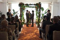 <p>Phil Fung (R) holds hands with Shawn Klein, his life-partner of 18 years, during their marriage ceremony on the 61st floor of the Empire State Building in New York, February, 14, 2012. REUTERS/Andrew Burton</p>