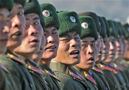 A North Korean soldier cries as he marches during a military parade to mark the birth anniversary of the North's late leader Kim Jong-Il in Pyongyang, in this photo taken by Kyodo, February 16, 2012. A smiling Kim Jong-un led celebrations of his dead father's official 70th birthday celebrations in the North Korean capital on Thursday, nearly two months after taking power, indicating a smooth transition in the one of the world's most closed states. Mandatory Credit REUTERS/Kyodo