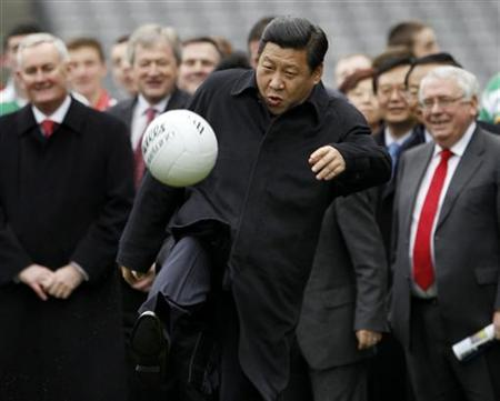 China's Vice-President Xi Jinping kicks a football during a visit to Croke Park in Dublin, Ireland February 19, 2012. REUTERS/David Moir