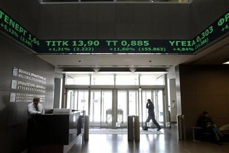 Rising stock prices are displayed at the reception hall of the Athens Stock Exchange in Athens February 17, 2012. REUTERS/Yiorgos Karahalis