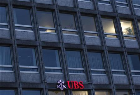An illuminated logo of Swiss bank UBS is pictured on an office building in Lucerne February 16, 2012. REUTERS/Michael Buholzer