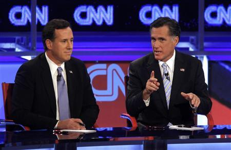 U.S. Republican presidential candidate former U.S. Senator Rick Santorum listens as former Massachusetts Governor Mitt Romney (R) speaks during the Republican presidential candidates debate in Mesa, Arizona, February 22, 2012. REUTERS/Joshua Lott