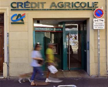 Passers-by walk in front of a branch of French bank Credit Agricole in Marseille, September 13, 2011. REUTERS/Jean-Paul Pelissier