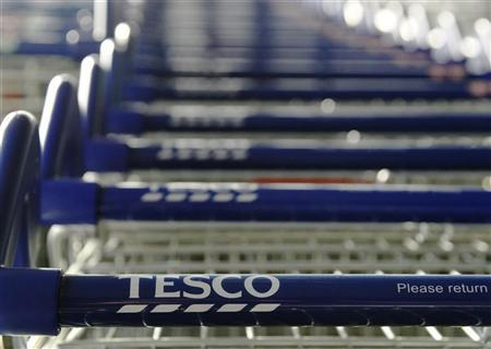 Trolleys are seen at a Tesco supermarket in London January 12, 2012. REUTERS/Luke MacGregor