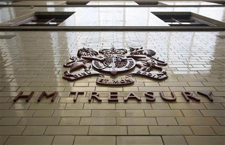 A shield of arms adorns a wall inside the Treasury in central London, October 20, 2010. REUTERS/Chris Ratcliffe/Pool