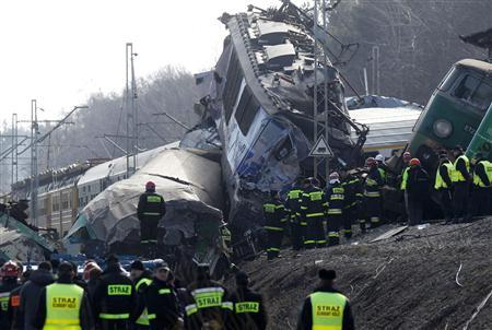 Polish emergency services work at the site of a train crash near the town of Szczekociny March 4, 2012. REUTERS/Peter Andrews