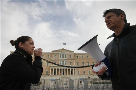 Protesters take part in an anti-austerity rally by health workers in front of the parliament in Athens February 23, 2012. REUTERS/John Kolesidis
