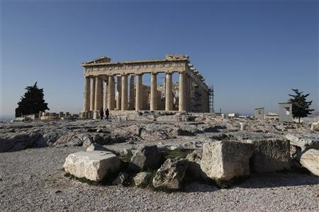 People walk at the archaeological site of the Acropolis in Athens January 19, 2012. REUTERS/Yiorgos Karahalis