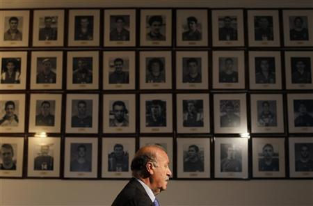 Spain's national soccer team coach Vicente del Bosque listens to a question during an interview with Reuters at the Spanish Soccer Federation headquarters in Las Rozas, outside Madrid March 6, 2012. REUTERS/Susana Vera