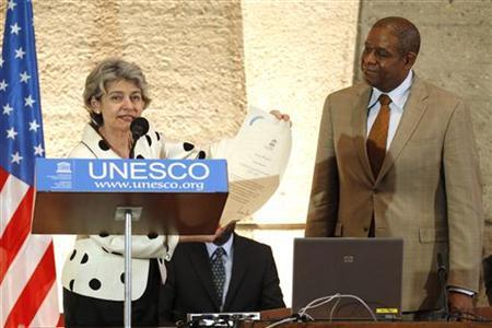UNESCO director general Irina Bokova (L) speaks alongside US actor Forest Whitaker (R) who attends a ceremony for his new role as a UNESCO Goodwill Ambassador in Paris, June 21, 2011. REUTERS/Benoit Tessier