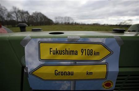 A farmer's tractor is decorated with the street signs of Fukushima and Gronau during a march of anti-nuclear protesters in the western German town of Gronau close to the Dutch/German border in North-Rhine Westphalia March 11, 2012. Reuters/Wolfgang Rattay