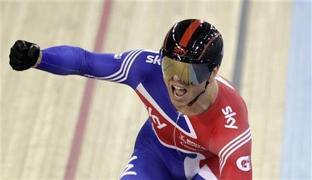 Team Britain cyclist Chris Hoy celebrates winning Gold in the Men's Sprint Race in the UCI Track Cycling World Cup at the Olympic Velodrome in London February 19, 2012. REUTERS/Cathal McNaughton
