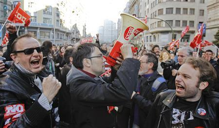 Protesters shout slogans during a general strike in central Madrid March 29, 2012. REUTERS/Juan Medina