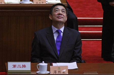 China's former Chongqing Municipality Communist Party Secretary Bo Xilai looks up as he attends the closing ceremony of the Chinese People's Political Consultative Conference (CPPCC) at the Great Hall of the People in Beijing, in this March 13, 2012 file photo. REUTERS/David Gray/Files