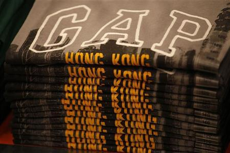 A stack of 'Gap Hong Kong' t-shirts are seen at Hong Kong's first Gap Store before its opening in the financial Central district November 25, 2011. REUTERS/Tyrone Siu