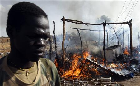 A SPLA soldier walks in a market destroyed in an air strike by the Sudanese air force in Rubkona near Bentiu April 23, 2012. REUTERS/Goran Tomasevic