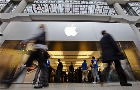 People walk by the Apple Store in the Eaton Centre shopping mall in Toronto in this March 16, 2012 file photo. Apple is expected to announce its first quarter earnings on April 24, 2012 after markets close. REUTERS/Mark Blinch/Files