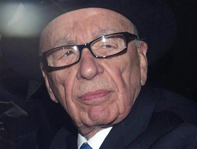News Corporation Chief Executive and Chairman Rupert Murdoch leaves after giving evidence at the Leveson Inquiry at the High Court in London in a April 26, 2012 file photo. REUTERS/Olivia Harris/files