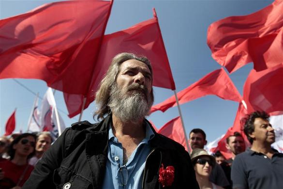 A unionist of the Greek Communist party takes part in a May Day rally outside the Hellenic Halyvourgia, a private-owned steel plant where steelworkers have been on strike for months over job losses, at Aspropyrgos suburb in the south of Athens, May 1, 2012.  REUTERS-Yorgos Karahalis