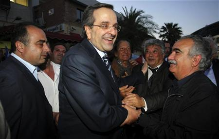 File photo of Greek conservative party leader Samaras greeting supporters during a pre-election rally in the town of Heraklion. REUTERS/Image Services/Stefanos Rapanis