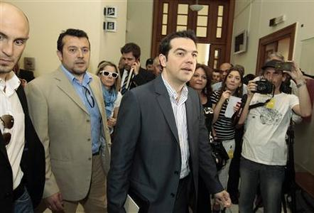 Head of Greece's Left Coalition party Alexis Tsipras (C) arrives for a meeting with Greek conservative party leader Antonis Samaras at the parliament in Athens May 7, 2012. REUTERS/Yorgos Karahalis