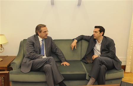 Greek conservative party leader Antonis Samaras (L) talks with head of Greece's Left Coalition party Alexis Tsipras at the parliament in Athens May 7, 2012. REUTERS/Willy Antoniou/Handout