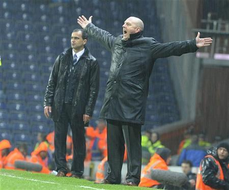 Blackburn Rover's coach Steve Kean (R) reacts during their English Premier League soccer match against Wigan Athletic in Blackburn, northern England May 7, 2012. REUTERS/Nigel Roddis