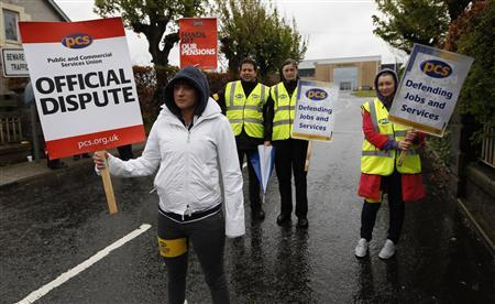 PCS union members hold placards, during a national day of strike action by the union, outside Saughton prison in Edinburgh, Scotland May 10, 2012. REUTERS/David Moir