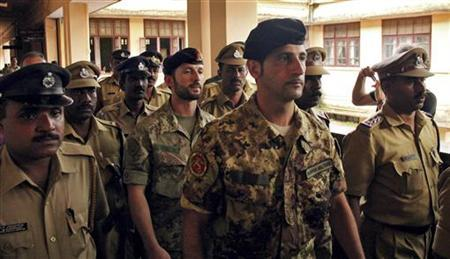 Salvatore Girone (C) and Latorre Massimiliano (3rd R), members of the navy security team of Napoli registered Italian merchant vessel Enrica Lexie, are escorted as they leave a courtroom at Kollam in the southern Indian state of Kerala March 5, 2012. REUTERS/Sivaram V