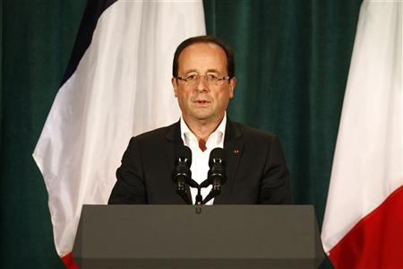 France's President Francois Hollande delivers a speech at the G8 summit in Camp David, May 19, 2012. REUTERS/Ludovic Marin/Pool
