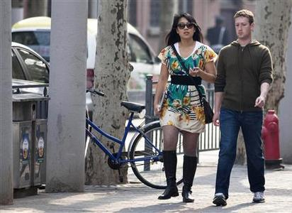 Facebook CEO Mark Zuckerberg and his girlfriend Priscilla Chan walk near Fuxing Road in Shanghai in this March 27, 2012, file photo. REUTERS/Stringer