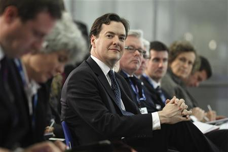 Britain's Chancellor of the Exchequer, George Osborne, listens to International Monetary Fund managing director Christine Lagarde speak at a news conference at the Treasury in London May 22, 2012. REUTERS/Oli Scarff/Pool